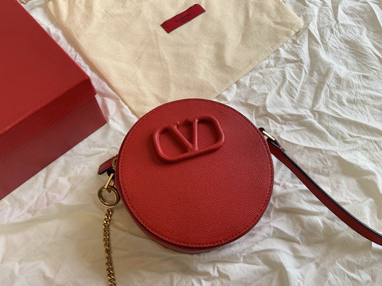 2020 Valentino Round VSling Shoulder Bag in red grained calfskin leather